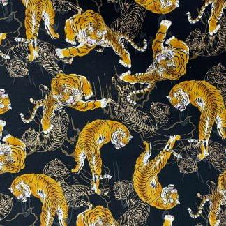 Tela algodón tigres sobre negro